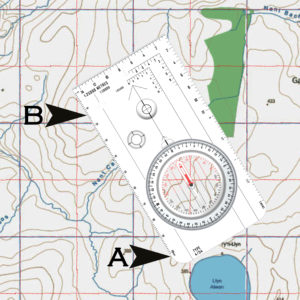Lay the baseplate of the compass flat on the map so that the edge goes between your position and the destination.